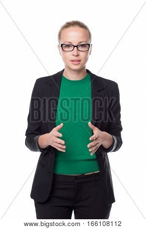 Black and white portrait of beautiful smart young businesswoman in business attire wearin black eyeglasses, standing with open body arm gesture against white background.