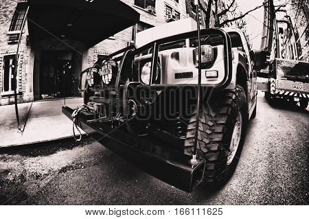 New York, June 1, 2016: A Hummer is parked in the streets of Manhattan. A moving crane is set up on the background.