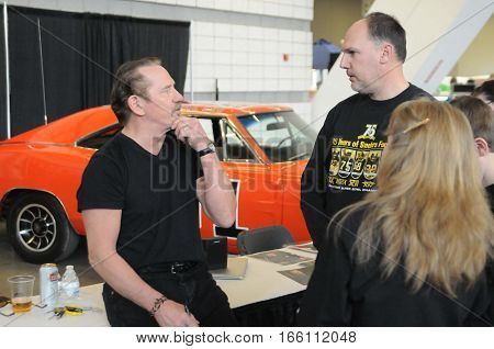 Tom Wopat (Luke Duke) of the Dukes of Hazzard interacting with fans of the hit series at an appearance at the World of wheels autoshow in Pittsburgh PA