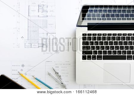 Construction equipment. Repair work. Drawings for building Architectural project blueprint rolls and divider compass on table. Engineering tools concept. Copy space.