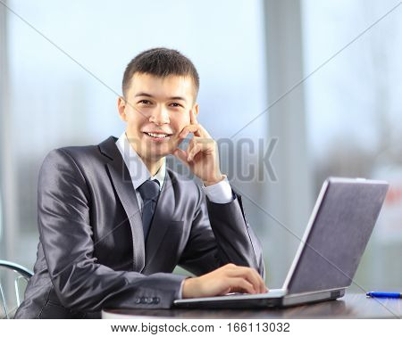 beginner businessman with laptop on workplace in the office