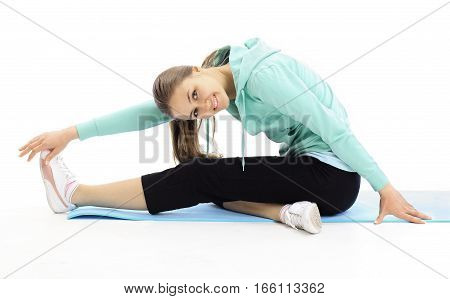 young woman performs fitness exercise for stretching muscles