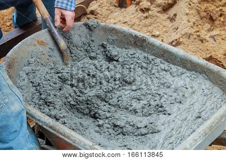 Man Mixing Mortar For Concrete Block Wall