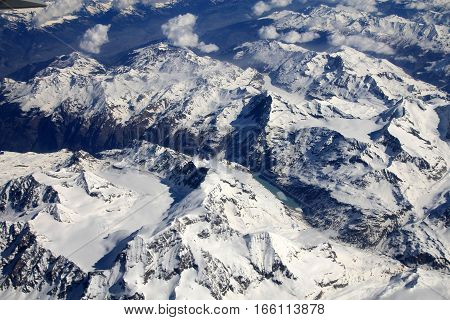 Birds eye view on mountains covered by snow as a natural background