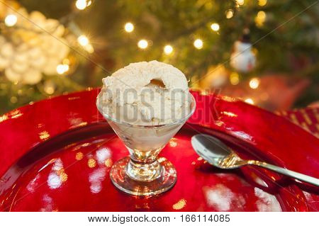 Dish of ice cream in front of the Christmas tree