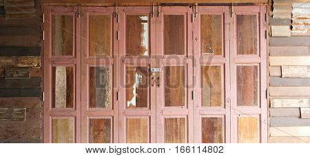 Brown old square pattern wooden doors with lock