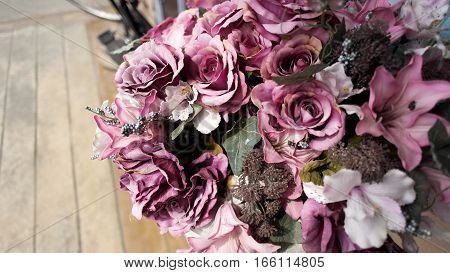 high angle artificial violet flower bonquet roses