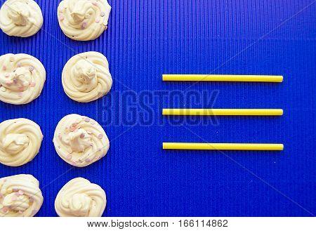 frame of meringue meringue on a blue background