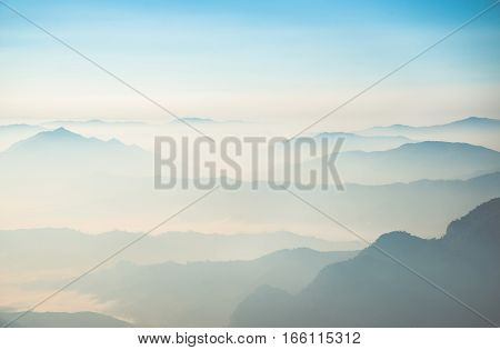 The beautiful scenery of mountains range view from above of Phu Chi Fah in Chiangrai province of Thailand.