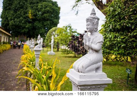 Old statue of buddha prayer at thai asian temple.
