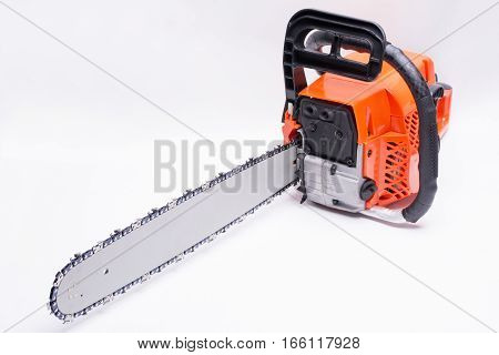 Engine powered chain saw placed diagonally on white background