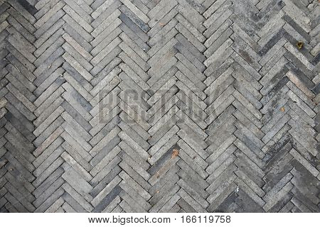 Floor walkway made of cement with gray stripes and has continued.