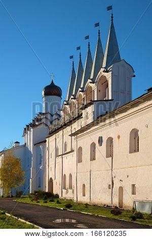 The bell tower of the Tikhvin Assumption monastery. October evening. Tikhvin, Russia