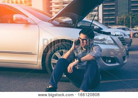 Young Asian Handsome Man Siting By The Broken Down Car