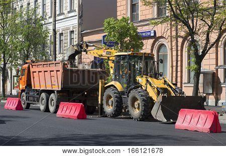 KRONSTADT, RUSSIA - MAY 30, 2015: Road construction on Lenin street