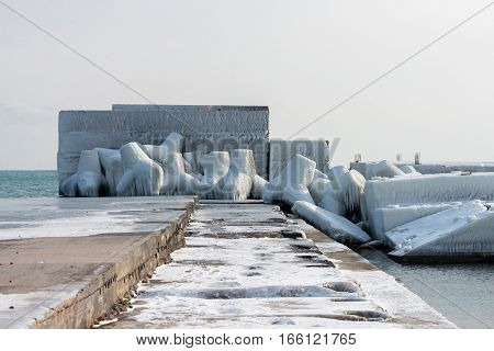 Concrete breakwater with snow and ice at Black sea cost