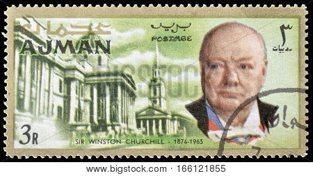 AJMAN - CIRCA 1966 : Cancelled postage stamp printed by Ajman, that shows Winston Churchill and National library.