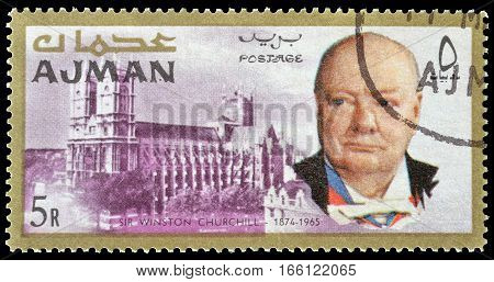 AJMAN - CIRCA 1966 : Cancelled postage stamp printed by Ajman, that shows Winston Churchill and Westminster Abbey.