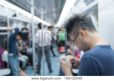 group of commuters inside subway train in Shanghai,China.