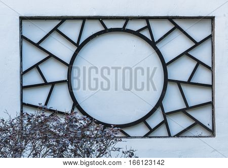 trational wooden window in chinese garden in city of China.