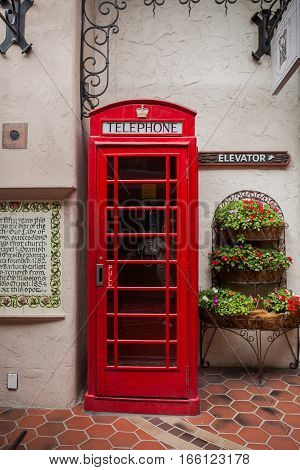 Traditional british old red telephone box on a street