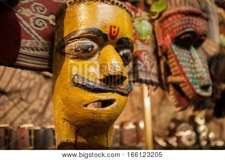 Traditional old masks in a store. Souvenir