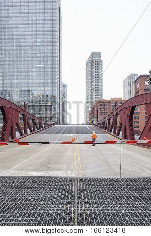 Chicago, Usa - October 15, 2016: An Unidentified Man Supervising The Opening Of Movable Bridge.