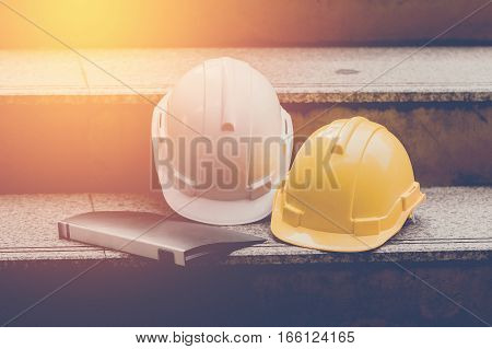White and yellow Helmet in construction site