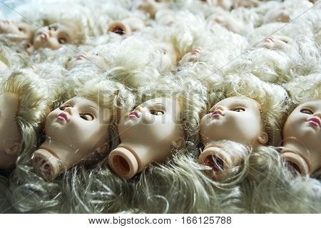 several children head doll with blue eyes lie in the old yard