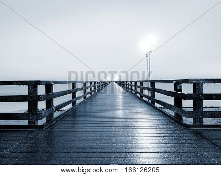Autumn Misty Morning On Wooden Pier Above Sea. Depression, Dark  Atmosphere.
