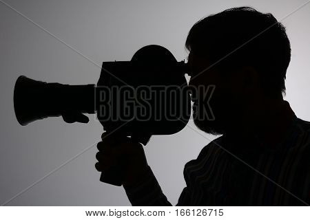 Silhouette Bearded Man Movie Camera Aside