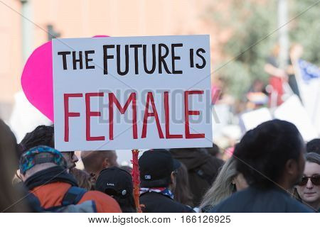 Woman Holding Sign About Female
