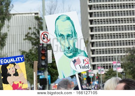 Activist Holds A Sign About  Russian President