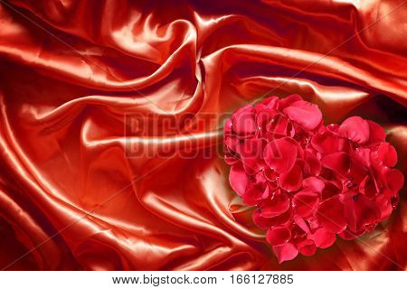 Rose petals on red fabric silk for background