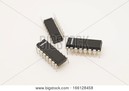 Three dual-inline package (DIP) integrated circuits on white background.