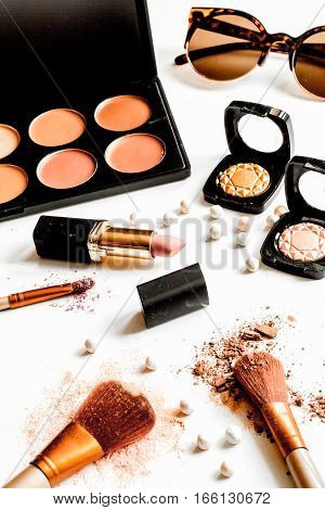 crushed decorative cosmetics nude on white background close up.