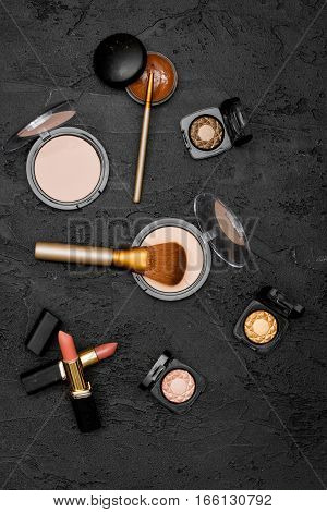 decorative cosmetics nude on dark background top view.