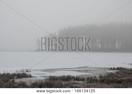 Smoky fog landscape of the lake in winter. Peno lake Tver oblast Russia.