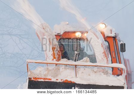Snow Truck Cleaning Snow From The Road And Streets Working At Sunset Light On Snowy Day