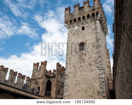 SIRMIONE, ITALY - MAY 5, 2016: Medieval castle Scaliger in old town Sirmione on lake Lago di Garda. Italy