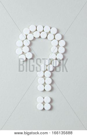 White Pills Question Mark