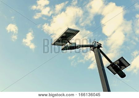small solar panel against blue skies and cloud