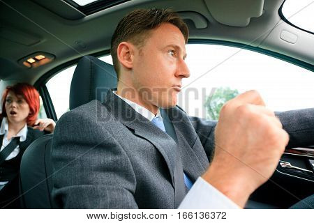 young business people on the road, annoyed because of he heavy traffic