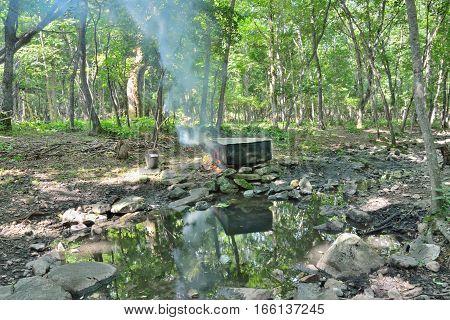 The medicinal bath at mineral spring with radon water in taiga.