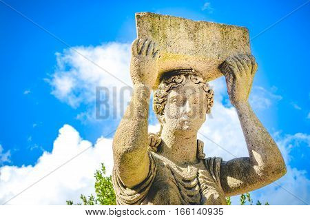 statue portrait blue sky half body hold up stone sculpture