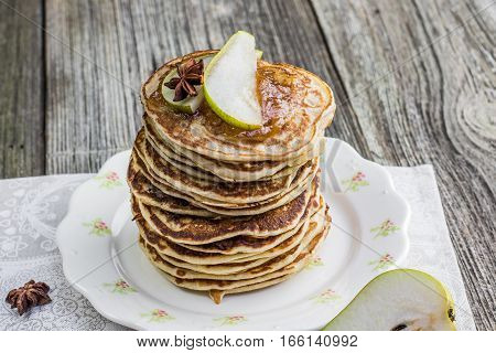 Whole Grain Pancakes With Pear Jam And A Slice Of Pear And Star Anise Folded To A Height