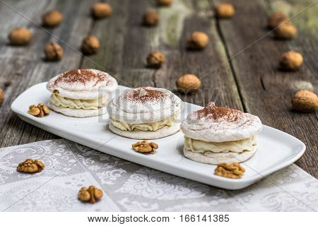 Walnuts Meringue With Cocoa With Walnuts In Background