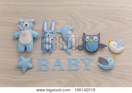 collection of soft toys and the word baby