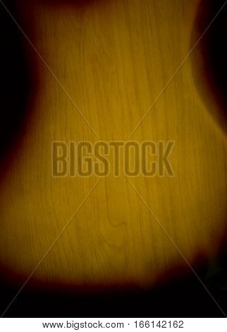 back of the lacquered wooden guitar soundboard