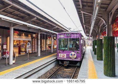 KYOTO JAPAN - November 21 2016 - Keifuku Randen Tram Line arriving at Arashiyama Randen Station from Shijo-Omiya.
